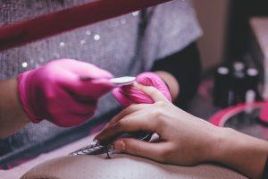 girl doing nail shaping